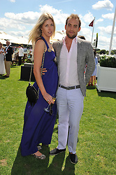 OPHELIA HOHLER and LUKE GAMBLE at the 27th annual Cartier International Polo Day featuring the 100th Coronation Cup between England and Brazil held at Guards Polo Club, Windsor Great Park, Berkshire on 24th July 2011.