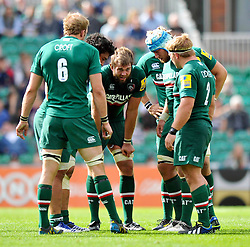 Leicester Tigers forwards huddle together during a break in play - Photo mandatory by-line: Patrick Khachfe/JMP - Tel: Mobile: 07966 386802 - 08/09/2013 - SPORT - RUGBY UNION - Welford Road Stadium - Leicester Tigers v Worcester Warriors - Aviva Premiership.