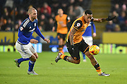 Hull City striker Abel Hernandez (9) and Matthew Connolly of Cardiff City  fight for the ball  during the Sky Bet Championship match between Hull City and Cardiff City at the KC Stadium, Kingston upon Hull, England on 13 January 2016. Photo by Ian Lyall.