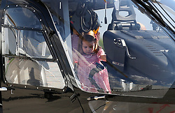 Princess Charlotte sits in a rescue helicopter as she visits Airbus in Hamburg, Germany with her parents and brother.