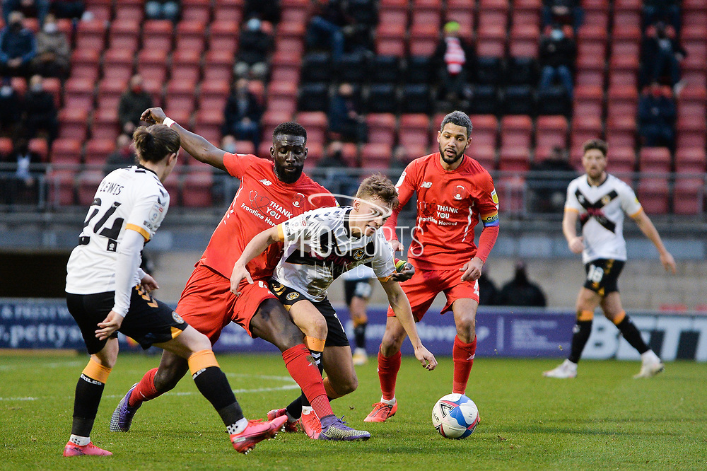 Scott Twine of Newport County battles for possession with Leyton Orient's Ousseynou Cissé(4) during the EFL Sky Bet League 2 match between Leyton Orient and Newport County at the Breyer Group Stadium, London, England on 12 December 2020.