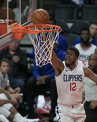 October 12, 2017 - Los Angeles, California, U.S - Tyrone Wallace #12 of the Los Angeles Clippers goes for a layup during their preseason game against the Sacramento Kings Thursday October 12, 2017 at the Galen Center in USC in Los Angeles, California. Clippers defeat Kings, 104-87. (Credit Image: © Prensa Internacional via ZUMA Wire)