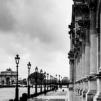 Cafe at the Louvre in Paris on a rainy October day and the Arc De Triomphe du Carrousel and Place Du Carrousel in the background