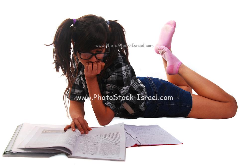 Teen Girl studies while lying on the floor