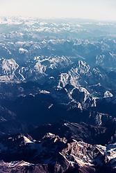 Aerial view of rocky mountain range covered with snow