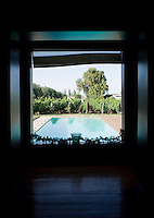 A view of the pool and the grape vines that surround Club Tapiz, a boutique hotel in the Luján de Cuyo area of Mendoza, Argentina.