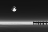 This combination of the moon with a pier is certain to appeal to those who love a sense of mystery. There is noir quality to this piece that cannot be denied. At the same time, there is also a quality to this piece that makes us feel as though we have been transported to another dimension entirely. Whether or not you believe that to be the case, there is definitely something of a supernatural tone to the atmosphere of this piece. There is no question that you can enjoy this fine art piece in just about any space you may want. .<br /> <br /> BUY THIS PRINT AT<br /> <br /> FINE ART AMERICA<br /> ENGLISH<br /> https://janke.pixels.com/featured/moonrise-and-pier-jan-keteleer.html<br /> <br /> WADM / OH MY PRINTS<br /> DUTCH / FRENCH / GERMAN<br /> https://www.werkaandemuur.nl/nl/shopwerk/Landschap---Maan-boven-de-zee-en-pier/443863/134