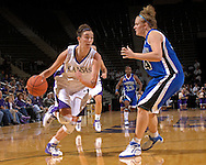 Kansas State forward Ashley Sweat (L) drives past Creighton center Kristina Voss (R) in the second half at Bramlage Coliseum in Manhattan, Kansas, November 13, 2006.  K-State defeated the Bluejays 94-79.<br />