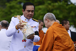 July 28, 2017 - Bangkok, Bangkok, Thailand - Thai Prime Minister Prayuth Chan-O-Cha gives alms to Buddhist monks to celebrate the birthday of Thai King Maha Vajiralongkorn in Bangkok, Thailand, July 28, 2017. (Credit Image: © Anusak Laowilas/Pacific Press via ZUMA Wire)