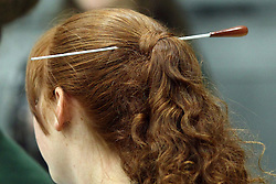 10 January 2015:  Student band director sporting the baton as a hair piece during an NCAA mens division 3 CCIW basketball game between the Carthage Reds and the Illinois Wesleyan Titans in Shirk Center, Bloomington IL
