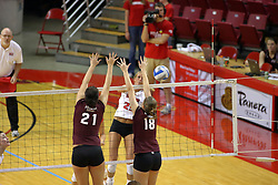 31 OCT 2008: Mallory Leggett strikes the ball to the outside of the dual block attempt by Calli Norman and Julia Cawthra during a match in which the Missouri State Bears defeated the Redbirds of Illinois State 3 sets to 2 on Doug Collins Court inside Redbird Arena in Normal Illinois