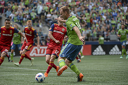 May 26, 2018 - Seattle, Washington, U.S - MLS Soccer 2018: Sounder defender CHAD MARSHALL (14) iputs pressure on the RSL defense in the last minutes of the match as Real Salt Lake visited the Seattle Sounders in a MLS match at Century Link Field in Seattle, WA. RSL won the match 1-0. (Credit Image: © Jeff Halstead via ZUMA Wire)