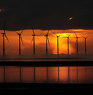 The sun setting behind the turbines of the Burbo Bank wind farm in Liverpool Bay at the mouth of the river Mersey. The Mersey is a river in north west England which stretches for 70 miles (112 km) from Stockport, Greater Manchester, ending at Liverpool Bay, Merseyside. For centuries, it formed part of the ancient county divide between Lancashire and Cheshire.