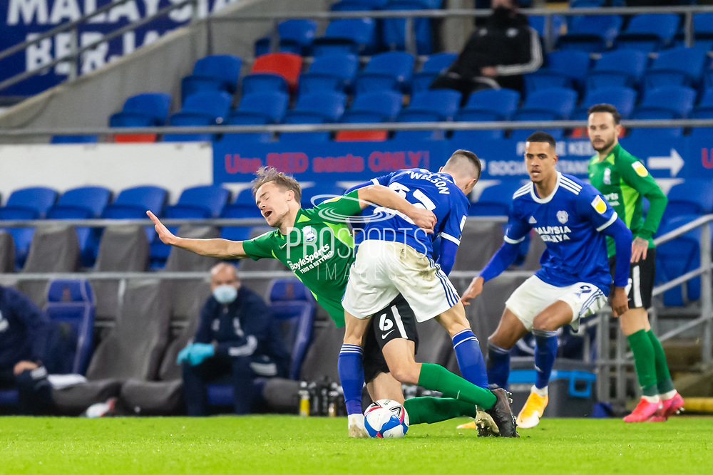 Birmingham City's Maikel Kieftenbeld (6) is fouled by Cardiff City's Harry Wilson (23) during the EFL Sky Bet Championship match between Cardiff City and Birmingham City at the Cardiff City Stadium, Cardiff, Wales on 16 December 2020.