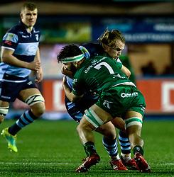 Kristian Dacey of Cardiff Blues is tackled by Colby Fainga'a of Connacht<br /> <br /> Photographer Simon King/Replay Images<br /> <br /> Guinness PRO14 Round 14 - Cardiff Blues v Connacht - Saturday 26th January 2019 - Cardiff Arms Park - Cardiff<br /> <br /> World Copyright © Replay Images . All rights reserved. info@replayimages.co.uk - http://replayimages.co.uk
