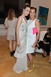 Left to right, AMBER LE BON and YASMIN LE BON at the annual Royal Academy of Art Summer Party held at Burlington House, Piccadilly, London on 4th June 2014.