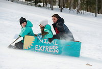 """Julia, Sarah and Nick Kelley get turned around and are heading south in their """"Miami Express"""" sled during the Laconia Parks and Recreation cardboard sled derby on Thursday afternoon.   (Karen Bobotas/for the Laconia Daily Sun)"""