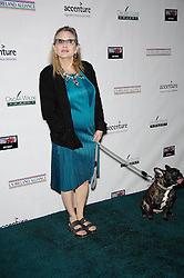 File photo dated 2/19/15 of Carrie Fisher, who has died at age 60