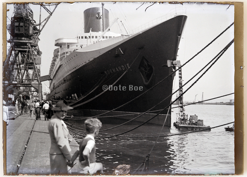 luxury passenger ocean liner SS Normandie moored in harbor 1930s