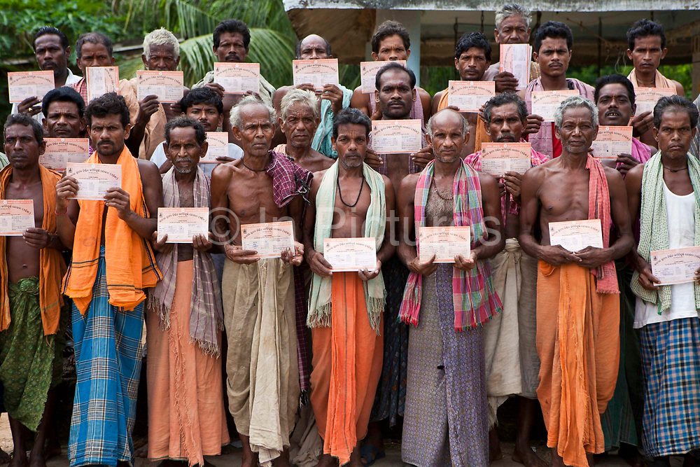 Local villagers with their newly acquired government work permits organized by CLAP.  Committee for Legal Aid to Poor (CLAP) is a non-profit organisation helping to provide legal aid to the poorer communities in the Orissa district of India.