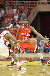 """03 February 2007: Keith """"Boo"""" Richardson bounces a pass, trying to avoid Matt Salley. In what is locally referred to as the War on Seventy Four, the Bradley Braves defeated the Illinois State University Redbirds 70-62 on Doug Collins Court inside Redbird Arena in Normal Illinois."""