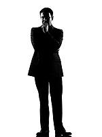 silhouette caucasian business man   thinking pensive expressing behavior full length on studio isolated white background