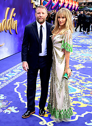 Guy Ritchie and Jacqui Ritchie attending the Aladdin European Premiere held at the Odeon Luxe Leicester Square, London.