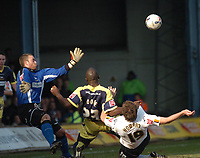 Photo: Ian Hebden.<br />Luton Town v Derby County. Coca Cola Championship. 18/03/2006.<br />Derbys Darren Moore (C) and Lutons Steve Howard (R) tangle for the ball.