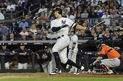 October 18, 2017 - Bronx, NY, USA - The New York Yankees' Aaron Judge hits an RBI double in the third inning against the Houston Astros in Game 5 of the American League Championship Series at Yankee Stadium in New York on Wednesday, Oct. 18, 2017. (Credit Image: © Andrew Savulich/TNS via ZUMA Wire)