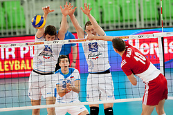 Mariusz Wlazly #10 of Poland, Danijel Koncilja #11 and Tine Urnaut #13 of Slovenia during volleyball match between National teams of Slovenia and Poland in 4th Qualification game of CEV European Championship 2015 on May 23, 2014 in Arena Stozice, Ljubljana, Slovenia. Photo by Urban Urbanc / Sportida