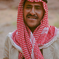 A Bedouin nomad wearing his keffiyeh head covering, poses in the Wadi Rum, Jordan. The rope atop his head is called an agal.
