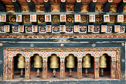 Prayer wheels, an ubiquitous sight in Bhutan, are revolving cylinders filled with printed prayers that are 'activated' each time the wheel is turned clockwise. Buddhist monks and devotees turn prayer wheels to gain merit and to concentrate the mind on the mantras and prayers they are reciting.