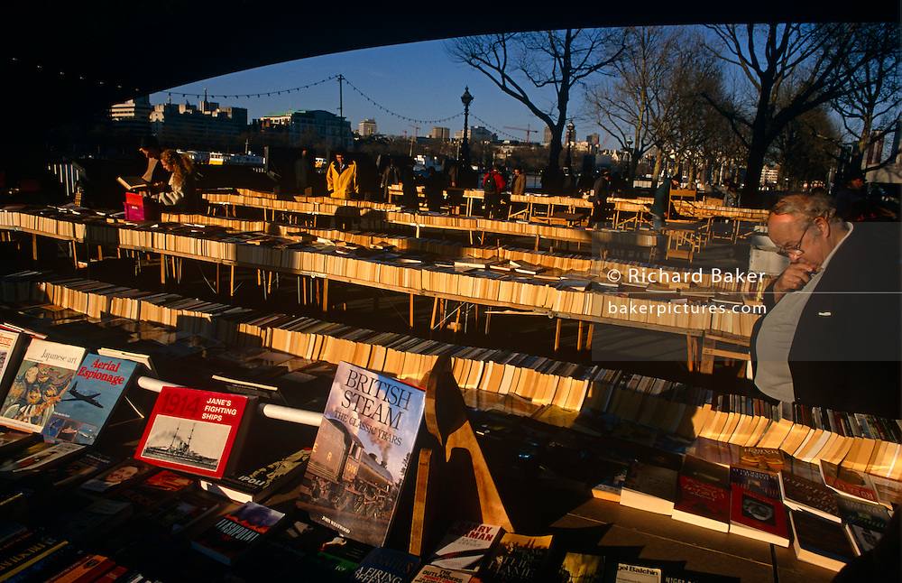 Paperbacks and hardbacks on sale at the well-known book stall beneath Waterloo Bridge on London's South Bank.