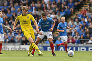 Oxford United Defender, Rob Dickie (4) beats Portsmouth Midfielder, Gareth Evans (26) to the ball during the EFL Sky Bet League 1 match between Portsmouth and Oxford United at Fratton Park, Portsmouth, England on 18 August 2018.