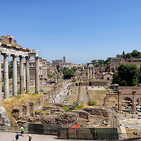 Rome. Italy. View of the Temple of Saturn dating from 42 BC with eight of its un-fluted granite columns dating at the Roman forum. The Roman Forum was the centre of political, commercial and judicial life in ancient Rome.
