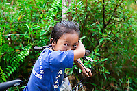 A shy young girl who said she was on her way to school in the countryside surrounding Bario in the Kelabit Highlands, Sarawak.