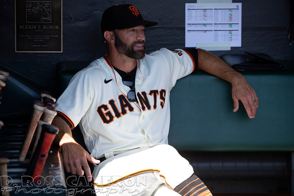 Oct 3, 2021; San Francisco, California, USA; San Francisco Giants manager Gabe Kapler (19) sits in the dugout before his team takes on the San Diego Padres at Oracle Park. Mandatory Credit: D. Ross Cameron-USA TODAY Sports