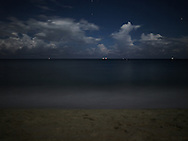Mysteriously calm ocean waters at night in Dong Hoi, Quang Binh Province, Vietnam, Southeast Asia