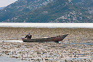 Local fisherman in his boat in Lake Skadar National Park, Montenegro. © Rudolf Abraham