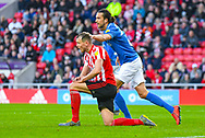 Christian Burgess of Portsmouth (6) reacts with Charlie Wyke of Sunderland (9) during the EFL Sky Bet League 1 first leg Play Off match between Sunderland and Portsmouth at the Stadium Of Light, Sunderland, England on 11 May 2019.