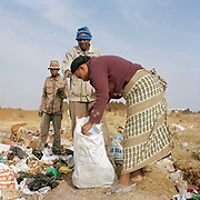 David (58) photographed collecting rubbish at a local dump with co workers, David was forced to make his living from the dumps following the Violence of the 2007/8 Kenyan elections . He lost his property when it was burned down and his living ( he had cows and would sell milk)  . He is a member of the Kikyu tribe who were targeted. Over a thousand people were killed and many maimed or injured, many from this area. He has a daughter in grade 2 he has to feed who is at school.
