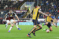 Sam Vokes of Burnley shoots and scores is teams 1st goal. The Emirates FA cup 4th round match, Burnley v Bristol City at Turf Moor in Burnley, Lancs on Saturday 28th January 2017.<br /> pic by Chris Stading, Andrew Orchard Sports Photography.