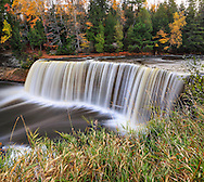 A very picturesque waterfall with silky motion blur, Tahquamenon Falls in Autumn, Michigan's Upper Peninsula, USA