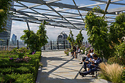 Lunchtime City workers enjoy a tranquill lunchtime high above the City on the rooftop garden at Fen Court in the City of London, the capitals financial district aka the Square Mile, on 22nd August 2019, in London, England.