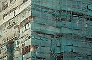 Tattered high rise scaffolding, Hanoi, Vietnam