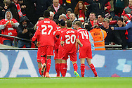 Philippe Coutinho of Liverpool (not in view) celebrates with his teammates after scoring his teams 1st goal. Capital One Cup Final, Liverpool v Manchester City at Wembley stadium in London, England on Sunday 28th Feb 2016. pic by Chris Stading, Andrew Orchard sports photography.