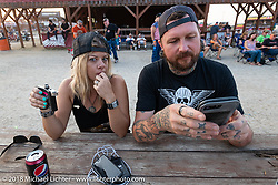 Krystal Hess and Chris Moos at the Buffalo Chip during the 78th annual Sturgis Motorcycle Rally. Sturgis, SD. USA. Friday August 10, 2018. Photography ©2018 Michael Lichter.