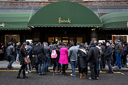 © Licensed to London News Pictures. 26/12/2013. London, UK. Shoppers queue for the start of the world famous Harrods department store Boxing Day sale in London today (26/12/2013). Photo credit: Matt Cetti-Roberts/LNP