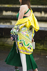 March 4, 2018 - Paris, France - A guest wears a green dress, a yellow flower print jacket, a studded bag, outside Valentino, during Paris Fashion Week Womenswear Fall/Winter 2018/2019, on March 4, 2018 in Paris, France. (Credit Image: © Nataliya Petrova/NurPhoto via ZUMA Press)