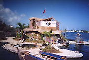"""Eco-pioneer Richard """"Rishi"""" Sowa designed and built an artificial island kept afloat by 100,000 plastic bottles.<br /> <br /> Spiral Island II is actually Rishi Sowa's second artificial island. He built the first one in 1998, near Puerto Aventuras, using 250,000 plastic bottles to keep it afloat. Sadly, his recycled island was destroyed in 2005, when Hurricane Emily passed through the area. Most of Spiral Island was washed up on the beach, but Sowa decided to build a whole new island, in a safer area.<br /> <br /> And that's how Spiral Island II came to be. With the help of volunteers, Rishi Sowa gathered around 100,000 plastic bottles and hand-built his second recycled island, in a lagoon that offers protection from bad weather. The new island features a house, beaches, 2 ponds and a solar-powered waterfall, but its creator says Spiral Island II is and always will be an eco-work-in-progress. Although smaller than its predecessor (only 20 meters in diameter), you can expect the new Spiral Island to increase in size, significantly.<br /> <br /> One of the most impressive DIY projects ever attempted, Spiral Island has inspired volunteers to come to Mexico and help Rishi Sowa improve his creation. But while some believe it a perfect environmental design, built entirely of recycled materials, there is some controversy surrounding Spiral Island. There are those who believe that if the island gets destroyed by a hurricane, again, the materials used to build it (mainly plastic bottles, sand, mangrove plants) will litter the waters of the Atlantic.<br /> Photo Shows; Rishi's Bottle Island<br /> ©Spiral Island /Exclusivepix"""